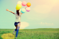 stock-photo-59960644-young-asian-woman-running-and-jumping-with-colored-balloons